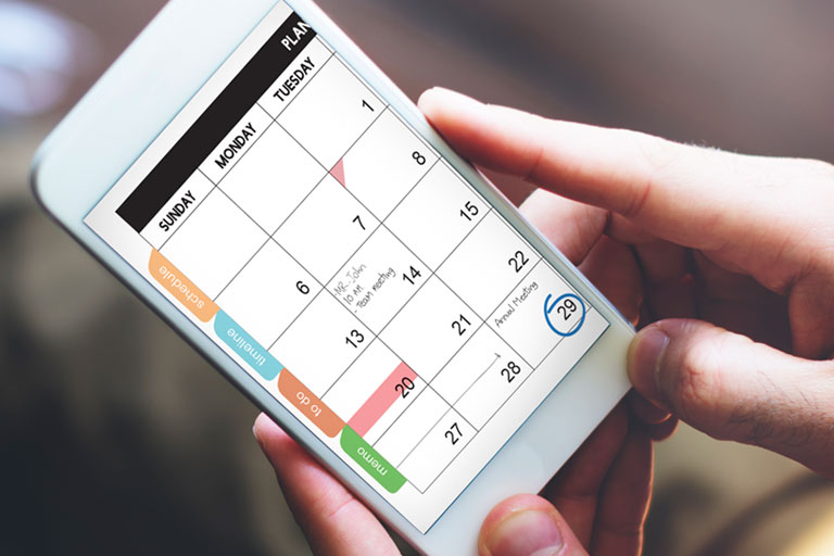 patient using calendar on phone - call for appointment