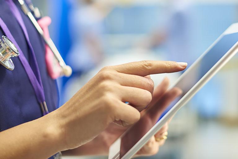 Physician on tablet - INN patient portal